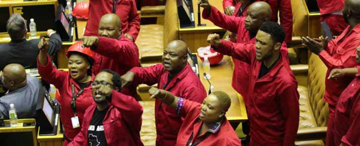 Members of the opposition Economic Freedom Fighters (EFF) party object as South African President Cyril Ramaphosa attempts to deliver his State of the Nation address at Parliament in Cape Town on 13 February 2020. Picture: AFP
