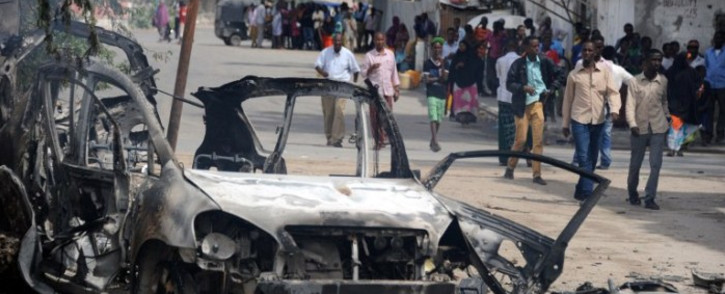 FILE: The site of a major car bomb and gun attack against an intelligence headquarters and detention facility in the centre of Mogadishu, which police said left at least seven militants dead on 31 August 2014. Picture: AFP.
