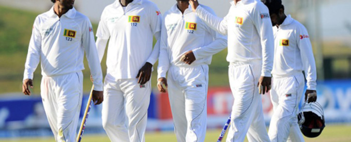 Sri Lanka cricket captain Angelo Mathews (2L) and teammates leave the pitch at the close of play on the final day of the first cricket Test match between Pakistan and Sri Lanka at the Sheikh Zayed Stadium in Abu Dhabi on January 4, 2014. The first Pakistan - Sri Lanka Test ended in draw. Picture: AFP.