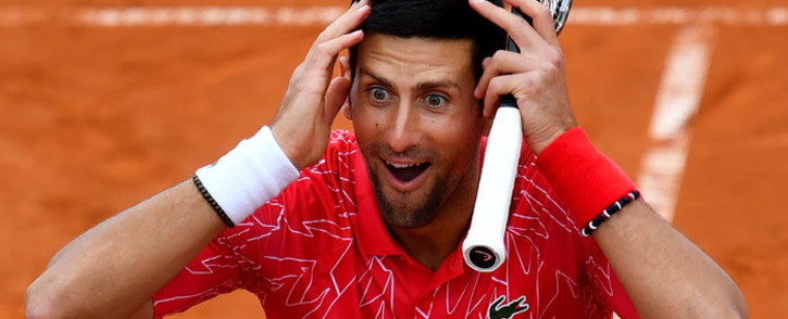 Serbia's Novak Djokovic reacts as he takes part in a tennis match during a charity exhibition hosted by him, in Belgrade on 12 June 2020. Picture: AFP