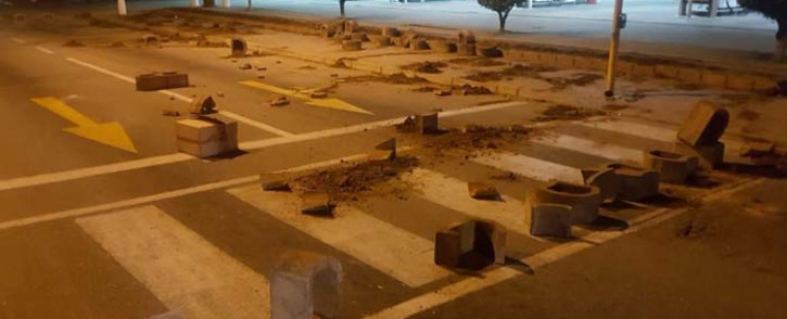 Bricks block a road following a service delivery protest in Thembalethu, George. Picture: SAPS