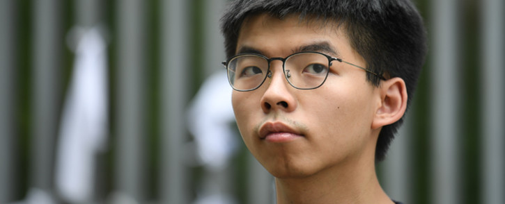 FILE: Hong Kong democracy activist Joshua Wong poses during an interview with AFP outside the government headquarters in Hong Kong on 18 June 2019. Picture: AFP.