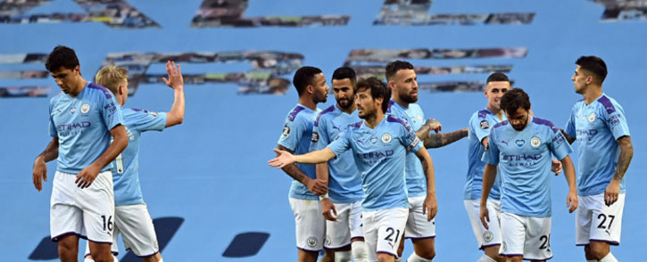 Manchester City midfielder David Silva (C) celebrates scoring the fourth goal during the English Premier League football match between Manchester City and Burnley at the Etihad Stadium in Manchester, north west England, on 22 June 2020. Picture: AFP