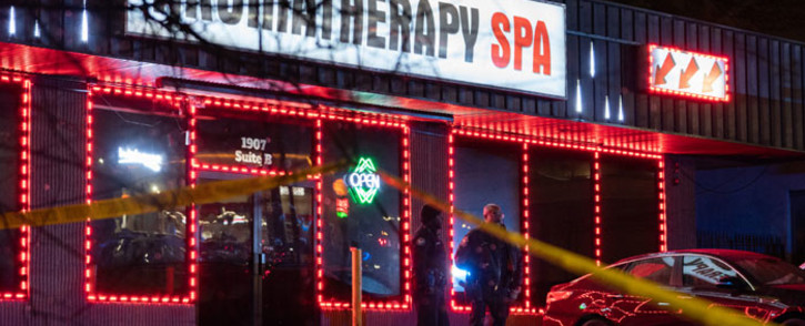 Law enforcement personnel are seen outside a massage parlor where a person was shot and killed on 16 March 2021, in Atlanta, Georgia. Picture: Elijah Nouvelage/AFP