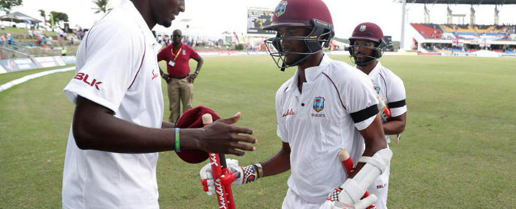 West Indies captain Jason Holder celebrates a Test win with teammates. Picture: Twitter.