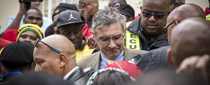 Security personnel crowd around Stellenbosch University's Vice Chancellor Wim de Villiers after receiving Sasco's memorandum after a protest march to the university. Picture: Thomas Holder/EWN