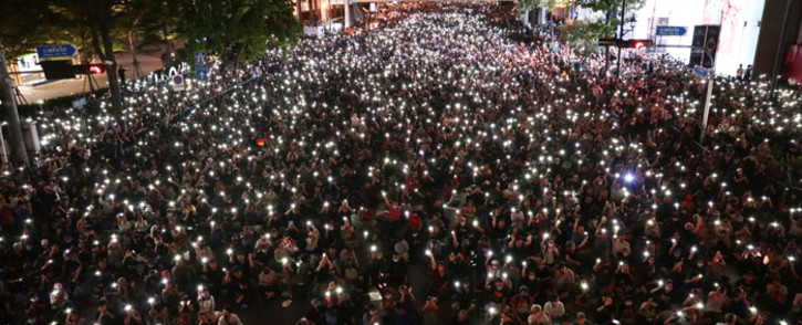Pro-democracy protesters hold up flashlights on the phones during a demonstration in Bangkok on 15 October 2020, after Thailand issued an emergency decree following an anti-government rally the previous day. Picture: AFP