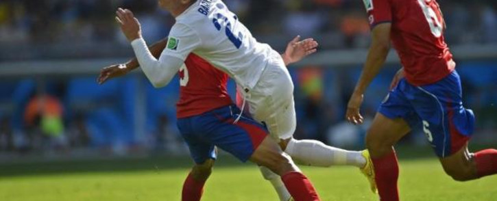 FILE: England's midfielder Ross Barkley (2nd R) clashes with Costa Rica's defender Giancarlo Gonzalez (L). Picture: AFP.