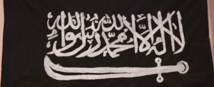 FILE: An Al-Shabaab flag. Picture: AFP