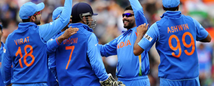 FLYING HIGH: The Indian cricket team celebrate after a wicket fall during a Champions Trophy match. Picture: AFP