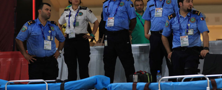 Members of the medical team watch as athletes compete in the Men's and Women's 50km Race Walk final at the 2019 IAAF World Athletics Championships in Doha on 29 September 2019. Picture: AFP
