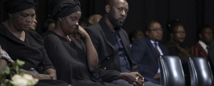 Enock Mpianzi's family sit quietly and sombre on stage during at a memorial service held at Parktown Boys' High. Picture: Xanderleigh Dookey/EWN