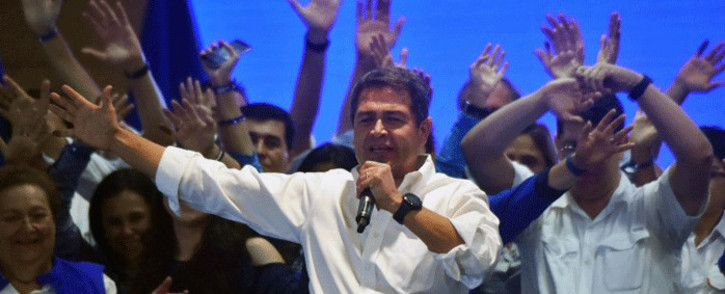 Honduran President and presidential candidate Juan Orlando Hernandez waves to supporters in Tegucigalpa after the general elections on 26 November, 2017. Picture: AFP.