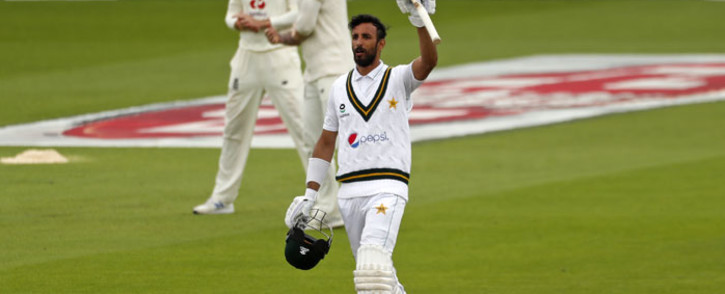 Pakistan's Shan Masood reacts after reaching his century during play on the second day of the first Test cricket match between England and Pakistan at Old Trafford in Manchester, north-west England on 6 August 2020. Picture: AFP