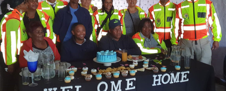 The Delft CPF host a party for Denzil Daniels (in blue) and his mother Jane Daniels (front left) after they returned from eSwatini on 30 June 2019 where the duo were reunited after Denzil disappeared from his Delft home in 2013. Picture: Supplied