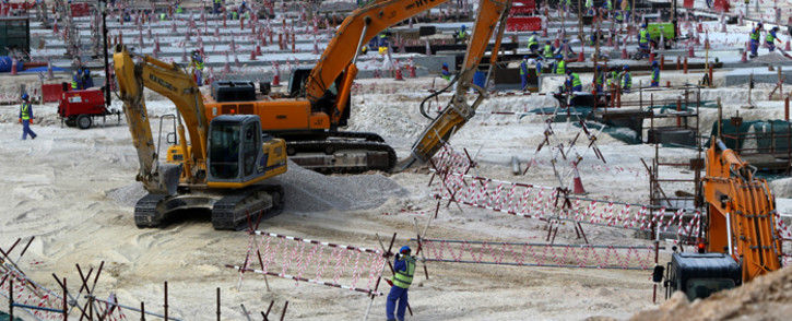 Foreign labourers work at the construction site of the al-Wakrah football stadium, one of the Qatar's 2022 World Cup stadiums, in May 2015. Picture: AFP.