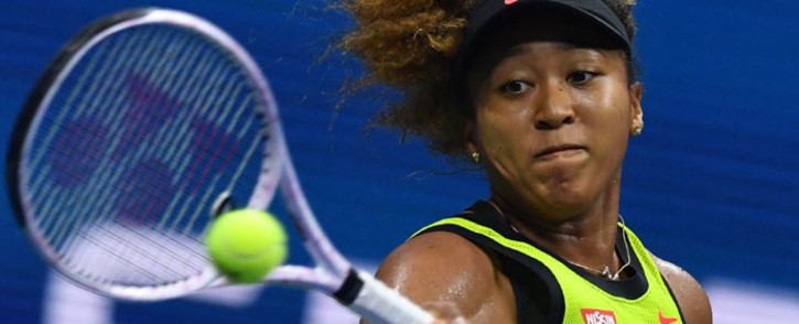Japan's Naomi Osaka hits a return to Czech Republic's Marie Bouzkova during their 2021 US Open Tennis tournament women's singles first round match at the USTA Billie Jean King National Tennis Center in New York, on 30 August 2021. Picture: Ed Jones/AFP