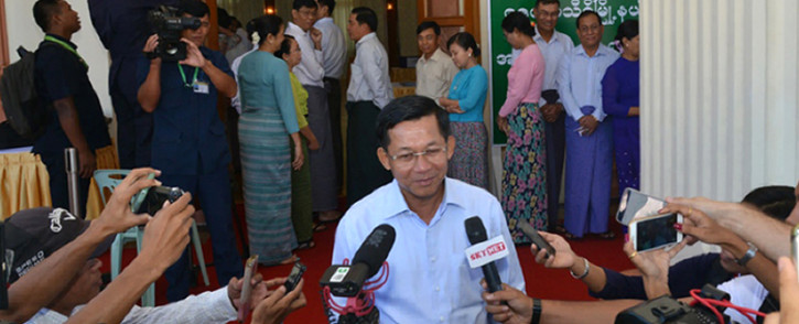 FILE: Myanmars Commander-in-Chief Min Aung Hlaing talking to journalists after casting his ballot at a polling center in Naypyidaw on 8 November 2015. Picture: AFP.