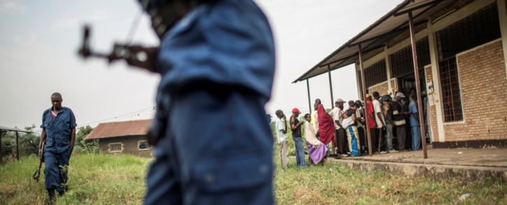 Burundian policemen secure a polling station in the Kinama neighborhood in Bujumbura on 29 June 2015. Picture: AFP.