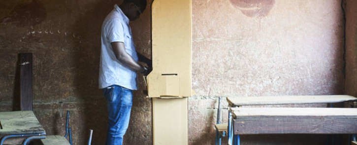 A man prepares to vote a polling station in Bamako on 12 August, 2018 during the second round of Mali's presidential elections. Picture: AFP