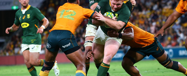 Australia's Samu Kerevi(L) tackles South Africa's Steven Kitshoff during the rugby Championship match at the Suncorp Stadium in Brisbane on 18 September 2021. Picture: AFP