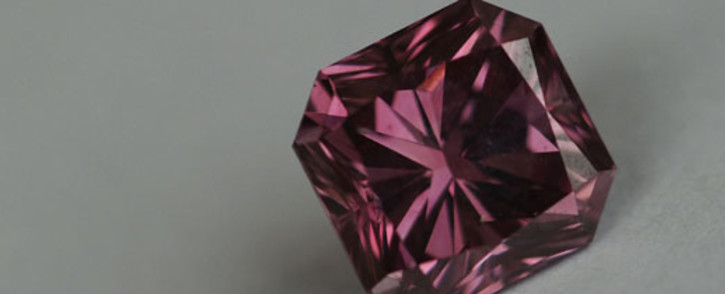 A Rio Tinto 1.32 carat square radiant pink diamond known as the Argyle Siren, which could easily fetch over $1 million, is seen in Hong Kong. Picture: AFP.