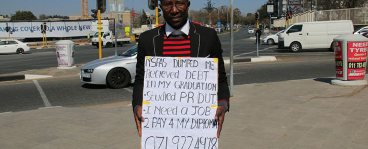 FILE: A graduate seeks employment by putting himself out there standing on a street corner. Picture: EWN