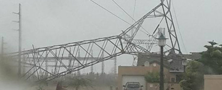 An electricity pylon has collapsed onto a house in Sunningdale. Picture: Laurene Hall Viljoen.
