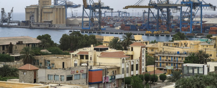 This file photo taken on 9 October 2021, shows an elevated view of the southern port of Port Sudan along the Red Sea in the country's northeast, with the Agricultural Bank of Sudan Grain Silos (L). From Washington to Moscow, Tehran to Ankara, Sudan's strategic Red Sea ports, blockaded for a month by protesters, have long been eyed by global powers far beyond Africa's borders. Picture: AFP