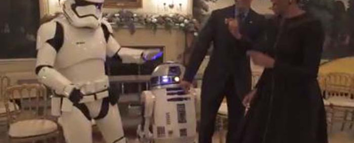 A screengrab of US President Barack Obama and first lady Michelle Obama dancing with a Stormtrooper and R2-D2 on Star Wars day.