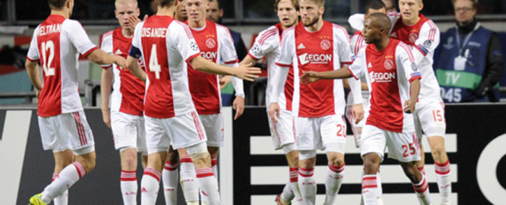 Ajax Amsterdam's Thulani Serero celebrates scoring a goal with teammates during the UEFA Champions League group H football match against FC Barcelona at the Amsterdam Arena on 26 November 2013. Picture: AFP.