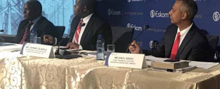 Zethembe Khoza, interim Chairman of the Eskom board (left), Johnny Dladla, interim Group CEO of the Eskom board (middle), Anoj Singh, Eskom CFO (right) on 19 July 2017 brief media on 2016 results. Picture: Kgothatso Mogale/EWN