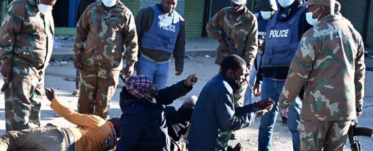 SANDF and SAPS members question suspected looters in Alexandra on 13 July 2021. Picture: @GovernmentZA/Twitter