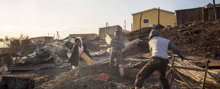 FILE: Children play in the debris of 40 shacks  that burnt down in White Location, an informal settlement in Knysna. Picture: Thomas Holder/EWN