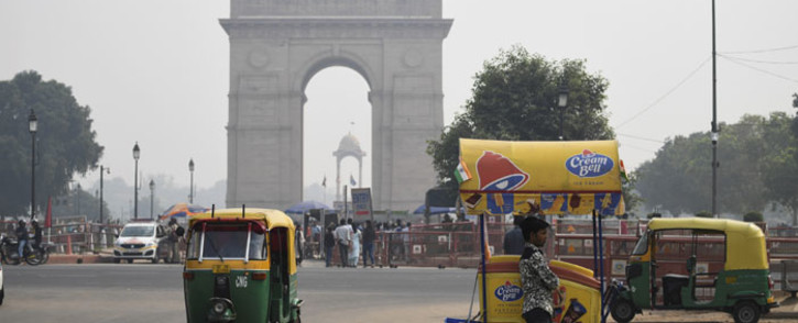 "An icecream vendor waits for customers under heavy smog near India Gate in New Delhi on 28 October 2019. Air quality in the Indian capital turned ""hazardous"" on October 28 after a night of frenzied fireworks by revellers defying a Supreme Court ban to celebrate the Hindu festival of lights, Diwali. Picture: AFP"