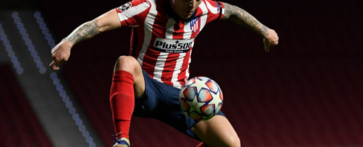 Atletico Madrid's English defender Kieran Trippier jumps for the ball during the UEFA Champions League group A football match between Atletico Madrid and Bayern Munich at the Wanda Metropolitano stadium in Madrid on December 1, 2020. Picture: Pierre-Philippe Marcou/AFP.
