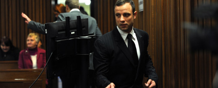 Murder-accused Oscar Pistorius arrives at the High Court in Pretoria for his trial on 2 July 2014. Picture: Pool.