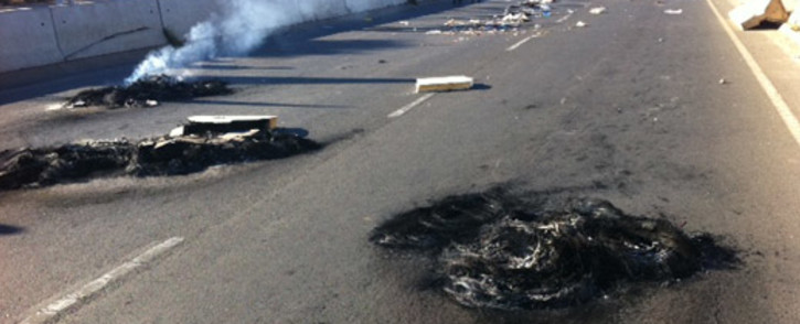 The scene of early morning protests in Zandspruit, Johannesburg, on 13 June 2012. Picture: Rahima Essop/EWN.