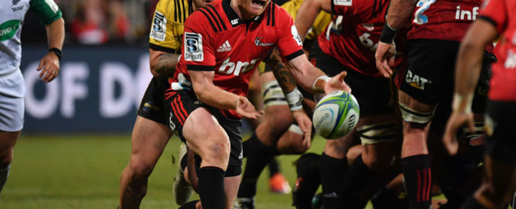 The Crusaders' Mitchell Drummond passes the ball during the Super Rugby semifinal match against the Hurricanes in Christchurch on 29 June 2019. Picture: AFP
