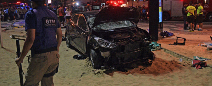The scene of a car crash pictured at Copacabana beach in Rio de Janeiro on 18 January, 2018. Picture: AFP.