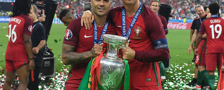 FILE: Portugal players with their Euro 2016 Cup after beating France on Saturday. Picture: @UEFAEURO.