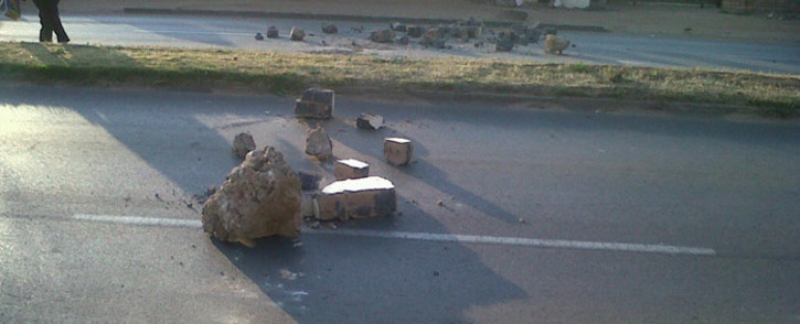 Residents blocked roads with rocks in Daveyton on 19 August 2014. Picture: EWN