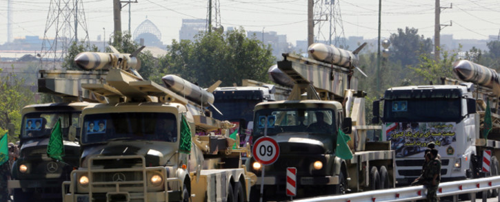 A file picture showing Iranian army trucks carry missiles during the annual military parade marking the anniversary of the start of Iran's 1980-1988 war with Iraq. Picture: AFP.