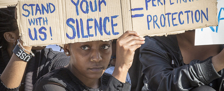 FILE: A UCT student holds up a poster during a protest against rape and sexual abuse on campus on 11 May 2016. Picture: Thomas Holder/EWN
