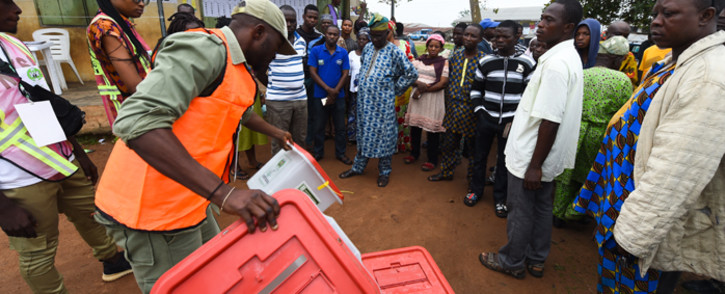 FILE: A Nigerian election official displays an empty ballot box to voters during the Osun State governorship election in Ede, southwest of Nigeria. Picture: AFP.