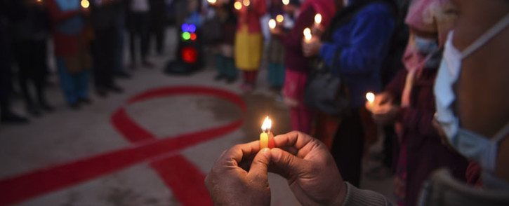 Volunteers light candles forming the shape of a red ribbon during an awareness event on the eve of the World Aids Day, in Kathmandu on 30 November 2020. Picture: AFP