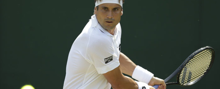 Spain's David Ferrer returns against Belgium's Steve Darcis during their men's singles second round match on the fourth day of the 2017 Wimbledon Championships at The All England Lawn Tennis Club in Wimbledon, southwest London, on July 6, 2017. Darcis retired in the first set. Picture: AFP.