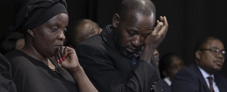 FILE: Anto Mpianzi and Ekila Guy Intamba, the parents of Enock Mpianzi, struggled to hold back their tears during a memorial service at Parktown Boys' High School. Picture: Xanderleigh Dookey/EWN