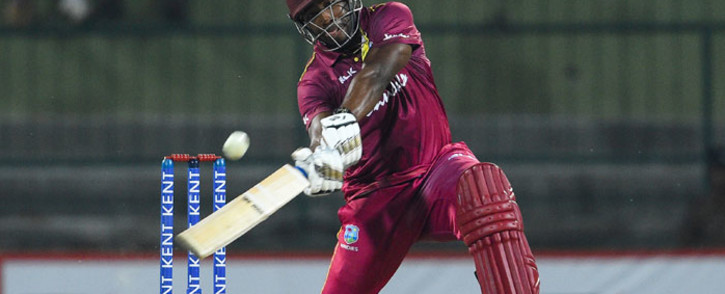 West Indies' Andre Russell plays a shot during the second Twenty20 international cricket match of a two-match series between Sri Lanka and West Indies at the Pallekele International Cricket Stadium in Kandy on 6 March 2020. Picture: AFP