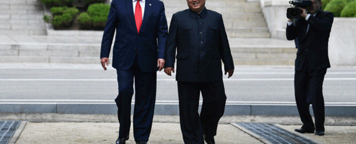 FILE: North Korea's leader Kim Jong Un walks with US President Donald Trump north of the Military Demarcation Line that divides North and South Korea, in the Joint Security Area (JSA) of Panmunjom in the Demilitarized zone (DMZ) on 30 June, 2019. Picture: AFP.